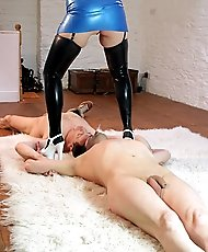 Mistress teasing and abusing two male slaves