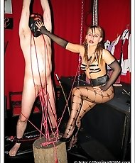 Rebeka torturing her tied-up slave, and showing off her sexy body.