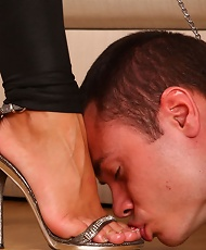 A mistress tough enough to train two humble pussy and toe lickers at once